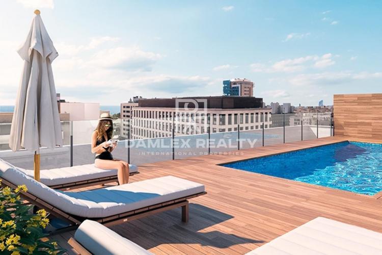 Appartement de trois chambres dans un immeuble neuf avec piscine